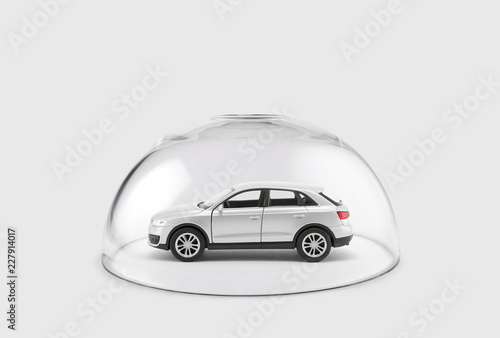 Fotografia Modern silver car protected under a glass dome