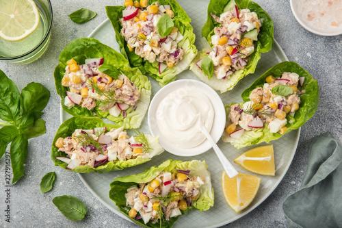 Fototapeta tuna salad lettuce wraps  on white plate obraz