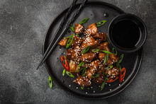 Sweet Sticky Pork Served With Chives And  Sesame Seeds