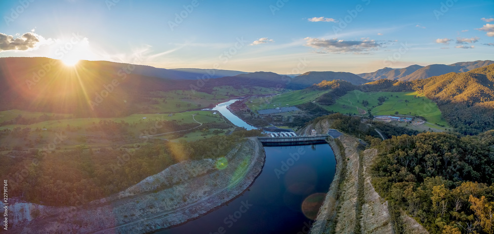 Fototapety, obrazy: Wide aerial panorama of Tumut river and mountains at sunset with sun flare. NSW, Australia