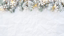 Christmas And New Year Holiday Background. Xmas Greeting Card. Spruce Tree On White Creased Background.