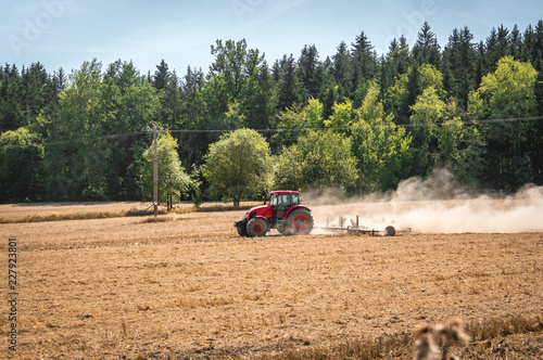Tractor plows a field - agriculture and agronomy concept