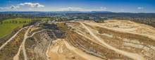 Wide Aerial Panorama Of Closed Limestone Mine And Surroundings On Bright Sunny Day. Melbourne, Australia