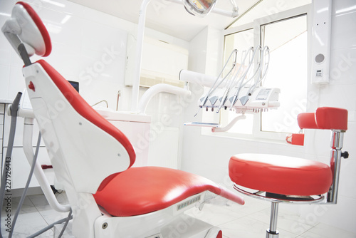 Dental clinic interior, design with chair and tools. All furniture in the same color
