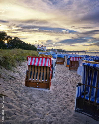 Sandy beach and traditional wooden beach chairs on island Rugen, Northern Germany, on the coast of Baltic Sea