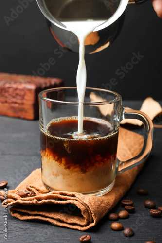 Tuinposter Chocolade Milk poured in glass