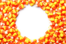 Colorful Candy Corns For Halloween Party On White Background, Top View