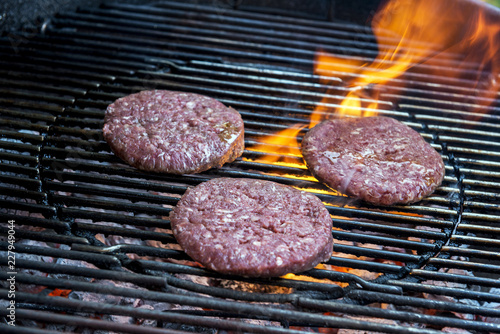 In de dag Grill / Barbecue Hamburgers are cooking on the grill