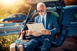 Young businessman travel with car