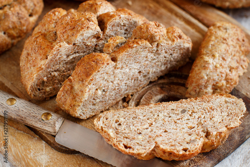 Spoed Foto op Canvas Brood Whole wheat bread on a Wooden Table