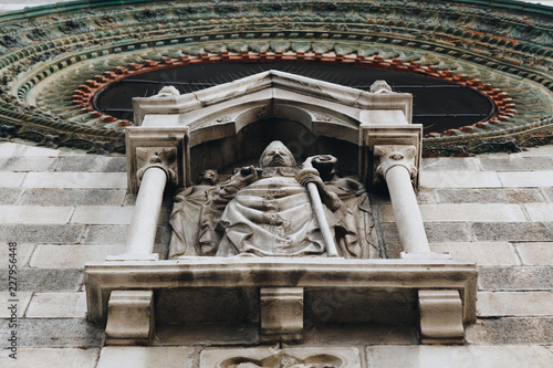 Fotografia, Obraz  Bellano Como Lake - Italy SEPT 2018 - Details of statue and decoration of the church of Saints Nazaro and Celso in Bellano