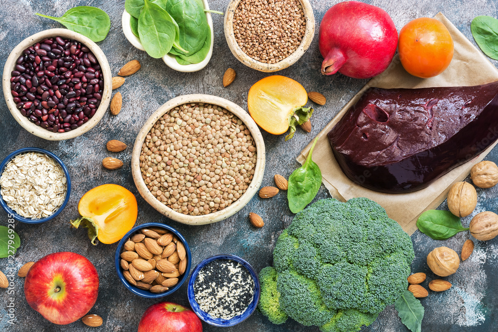 Fototapety, obrazy: Foods high in iron. liver, broccoli, persimmon, apples, nuts, legumes, spinach, pomegranate. Top view, flat lay.