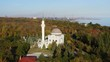 Mosque among autumn trees. Aerial drone footage.