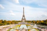 Fototapeta Fototapety z wieżą Eiffla - View on the Eiffel tower with fountains during the daylight in Paris