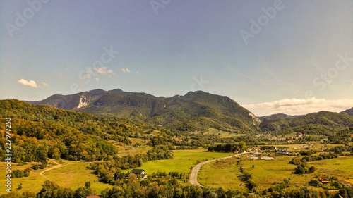 Aerial view of beautiful Transylvania. Carpathian mountains in autumn, sunset with beautiful collors and clouds.