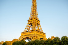 Close-up View On Eiffel Tower During The Sunset In Paris