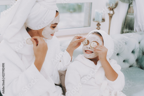 Poster Spa Happy Mother and Daughter Make Cucumbers Mask.