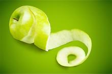 Green Apple Peeled With Twisting Skin