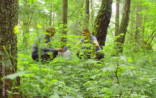 Valokuva  Man and woman scientists environmentalist in the forest
