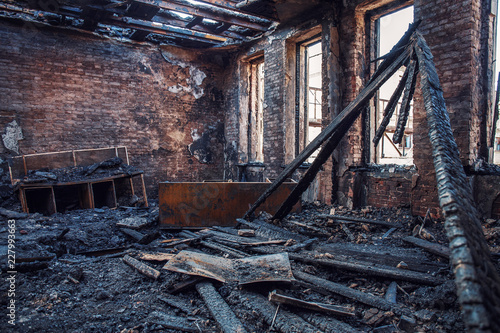 Burned house interior after fire, ruined building room inside, disaster or war a Canvas Print