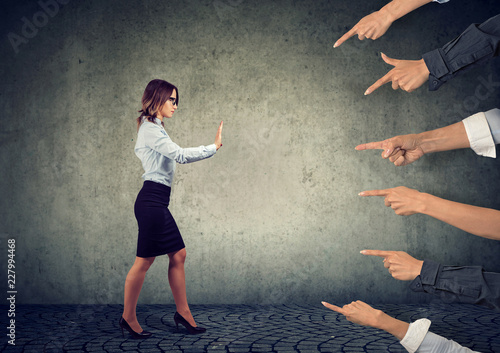 Confident woman keeping hands in stop gesture, trying to defend herself Canvas Print