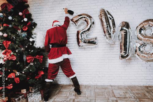 Fotografie, Obraz  Drunk Santa Claus near New Year Tree after Party.