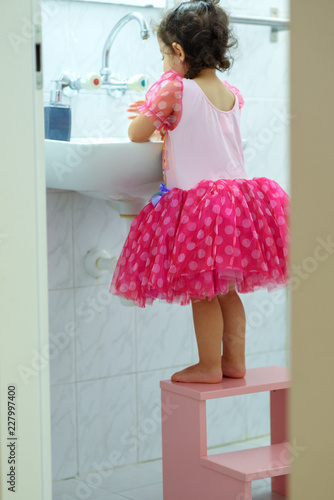 Fine Little Toddler Girl In Dress Stand On Kids Wood Chair In Uwap Interior Chair Design Uwaporg