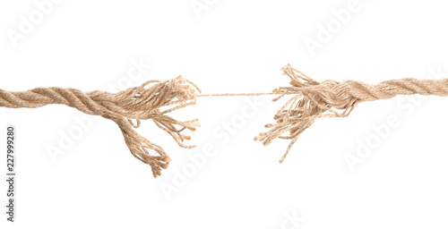 Valokuva  Frayed rope at breaking point on white background