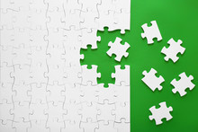 Puzzle Pieces On A Green Backg...