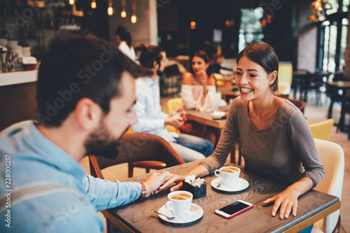 Fototapety, obrazy: Young happy couple at a date in a coffee shop