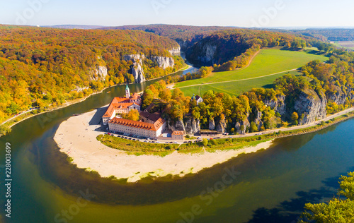 Foto op Canvas Monument Aerial view to Weltenburg Abbey - Kloster Weltenburg. This landmark is a Benedictine monastery in Weltenburg in Kelheim on the Danube in Bavaria, Germany.