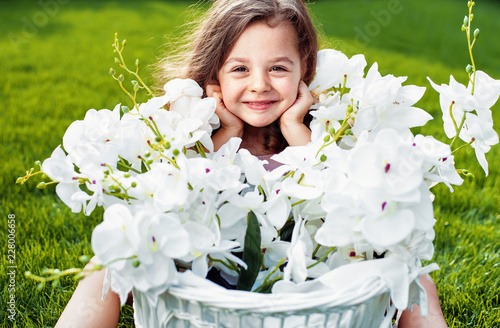 Foto op Canvas Artist KB Portrait of a cute smiling child with a flower basket