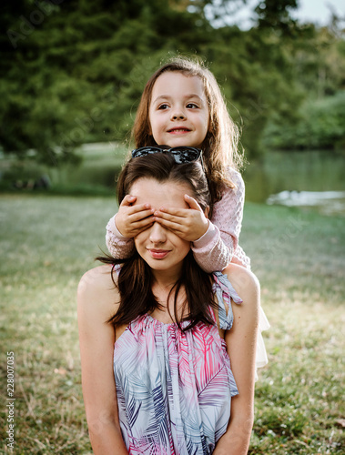 Foto op Canvas Artist KB Mother and daughter having a great fun in the park