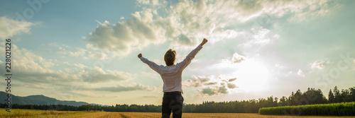 Businessman celebrating success in nature