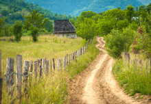 Small House With Widing Dirt R...