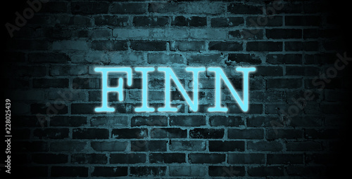 Valokuva first name Finn in blue neon on brick wall