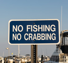 No Fishing And No Crabbing Sign In A Marina