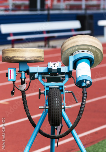Fotografie, Obraz  Football throwing pitching machine