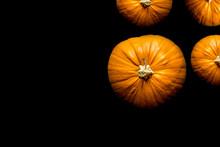 Overhead Shot Of Pumpkins On Black Background