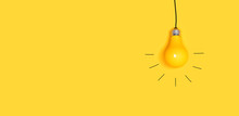One Hanging Light Bulb On A Yellow Background