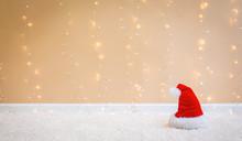 Santa Hat On A Carpet Over A Shiny Light Background