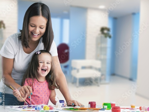 Happy family kid mom babysitter parent teacher