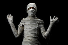 Studio Shot Portrait  Of Young Man In Costume  Dressed As A Halloween  Cosplay Of Scary Mummy Pose Like A Frightened Acting On Isolated Black Bancground