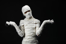 Studio Shot Portrait  Of Young Man In Costume  Dressed As A Halloween  Cosplay Of Scary Mummy Pose Like A Open Hand Acting On Isolated Black Background