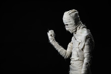 Studio Shot Portrait  Of Young Man In Costume  Dressed As A Halloween  Cosplay Of Scary Mummy Pose Like A Look At Right Hand Acting On Isolated Black Background