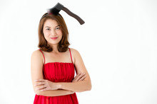 Woman In Red Dress With Fake Axe On Head On White Background. Concept For Funny Playing Costume In Halloween Festival