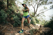 Young Woman Trail Runner Runni...