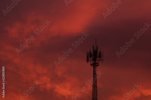 Fotobehang Bordeaux red sky at night and antenna