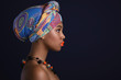canvas print picture - African woman with a colorful shawl on her head