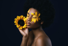 African Woman With A Sunflower...
